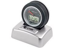 Часы «Авторалли» в виде автомобильного колеса на подставке с будильником. Можно включить функцию, при которой колесо будет вращаться с бешеной скоростью под звуки двигающейся на предельных скоростях машины и клаксона, дисплей, имитирующий тахометр, — подс купить